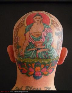 Buddha Tattoo & lotus on back of head.