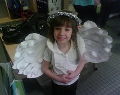 """Earth Day costume: angel wings made out of cheap white paper plates cut in half and layered/fanned out. Halo made of tin foil and 2 full plates with circles cut in the center for arm holes kept the costume totally """"recycled""""."""