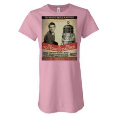 """This recreation of a 1960's boxing promotional poster features a matchup between The Doctor and his deadliest foes, the Daleks! Laced with actual information about the original airing of the loved and hated episode arc """"Daleks in Manhattan"""" this clever design is a stylish addition to any Doctor Who fan's collection.    Please specify a size and color when ordering.    Men's Sizes: XS, S, M, L, XL or XXL  Men's Colors: Asphalt, Athletic Heather, Light Blue, Red, White, Black    Women's Longer Length Sizes: S, M, L, XL or XXL  Women's Longer Length Sizes: Athletic Heather, Baby Blue, Black, Chocolate, Dark Grey Heather, Kelly, Leaf, Navy, Orange, Pink, Plum, Red, Teal, Team Purple, True Royal, Turquoise, White, Yellow (Please note--color options are different than the Women's V Neck Tees)    Women's V Neck Sizes: S, M, L, XL  Women's Colors: Baby Blue, Black, White, Red, Maroon, Ocean Blue, Leaf Green (Please note--color options are different than the Women's Longer Length Tees)    Kid's Sizes: XS, S, M, L, XL or XXL  Kid's Colors: Ash, White, Black, Carolina Blue, Daisy Yellow, Orange, Sport Gray, Light Pink, Light Blue"""