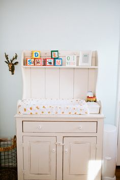Antique dining room hutch turned into a changing table - #nursery #vintage #nurserydecor
