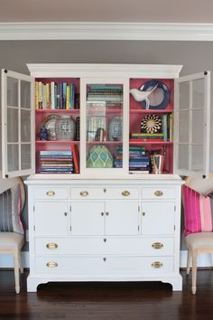 painted white hutch with painted pink shelves
