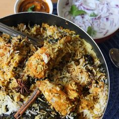 Spiced Marinated chicken, layered by basmati rice, Saffron, fried ...