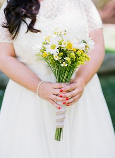 simple yellow and white bouquet,  photo by Valentina Glidden Photography http://ruffledblog.com/brookside-equestrian-wedding #weddingbouquet #flowers