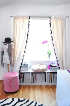 Love the idea of the super low bookcase under a bedroom window for storage!