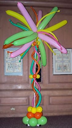 """Possible use for the large """"bubble line"""" balloons!!  Could use tan/green to make a palm tree"""