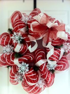 Candy cane striped Deco Mesh wreath with snowflake accents and Deco Flex ribbon