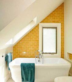 Needed an idea for a wall color to coordinate with turquoise bath fixtures and white and turquoise tiles ... yellow it is!