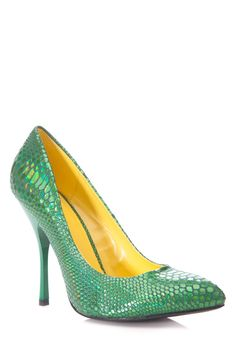 "For all the lady rebels here is the ""Poison Ivy Reptile Heels""! Gotta love a pair of statement heels to add some color and sheen to your look. Check them out on our online clothing store at www.cicihot.com #CiCihot #heels #poisonivy #scaleheels #reptileheels #pointyheels #green #greenheels #scales"