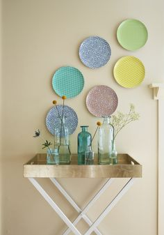 An easy DIY home decor project. Pick your favorite patterns, colors, or photos to create custom plates, and hang on your wall for an instant pop of color and fun.