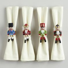 Wood Nutcracker Napkin Rings with swinging legs::Exquisitely detailed for a lovely holiday table setting.