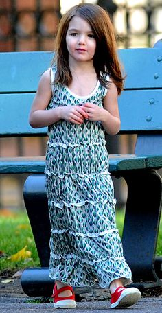 Polka maxi dress with mary jane sneaks... Personally I think it would look better with ballet flats or flip flops, but Suri can pull it.