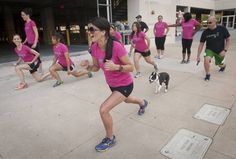 Teresa Martinez (center), who suffered a cardiac arrest after completing a half marathon, now works from the sidelines to inspire others.