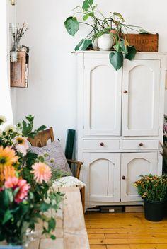 cupboard, hanging plants, rustic interiors, tv cabinets, pretti street, fresh flowers, nicol franzen, armoires, white furniture