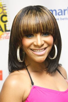 Teedra Moses flaunted a chic blunt-cut bang with perfect highlights at the ESSENCE Music Festival.