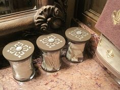 re-purposed WOODWICK candle jars love this!