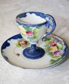 Made in Japan Hand Painted Blue Footed Tea Cup and Saucer