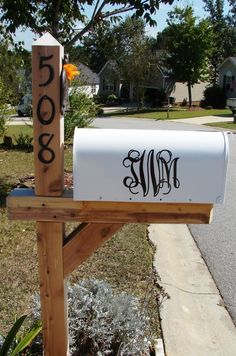 Vinyl family monogram on mailbox. Needs ribbon or paint to make it pop though :)