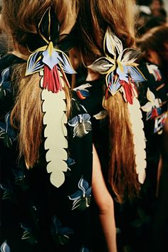 Tropical leather hair bands backstage at Fendi SS15 MFW.