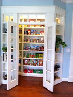add a pantry to a corner by building the wall out -- love the addition of transoms. This would work for office storage too.