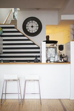 Black and white accent wall, under the stairs