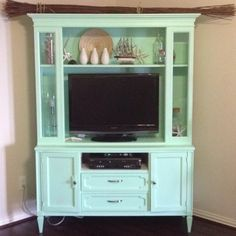 turn an old china hutch into a tv cabinet...Love this idea