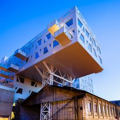 Innovation and conservation. Stoeperiet complex cantilevers above 19th century iron foundry. (Norway)