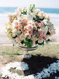 romantic peach roses decorating the ceremony site Photography: Carmen Santorelli Photography - carmensantorellistudio.com, Flowers by http://www.isariflowerstudio.com/  Read More: http://www.stylemepretty.com/2014/07/28/elegant-beachside-wedding-in-la-jolla-california/