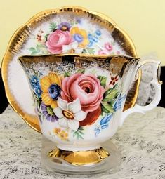 Vintage floral teacup and saucer with gold trim.  ROYAL ALBERT ENGLISH BONE CHINA