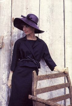 Audrey in a lovely aubergine suit and hat by Givenchy, photo by Howell Conant as seen in French Elle, 1962