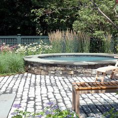 rock surrounding an above ground pool- pretty