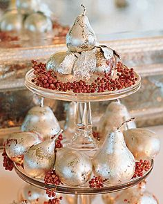 Shining Centerpiece:   For a traditional English Christmas dinner at her home in East Hampton, New York, Martha decorates with silver fruits reflected in a Venetian-glass mirror.