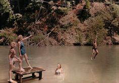 natgeofound: People swim and swing from ring to ring in the Russian River in California, August 1938.Photograph by B. Anthony Stewart, National Geographic