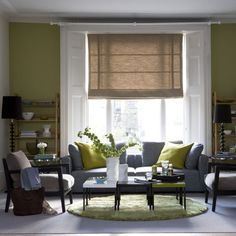 I have to work with pale green/light blue curtains.  Trying to feel out some inspiration.  Muted blue and green living room.