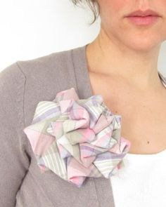 Vintage neckties upcycled into rosette brooches