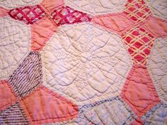 Pink and White Vintage Quilt with periwinkle pattern