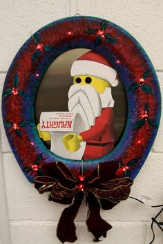 #2 - Black toilet seat wreath with Santa and his naughty list!