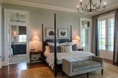 Master Bedroom featuring the Twist Chandelier and Ruhlmann Single Sconce in the master bath | design by Coastline Design Works, LLC