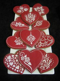 Valentines Day Cookies...believe these are stencilled on patterns with thin royal icing