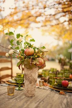 A Fall wedding centerpiece with pomegranates.