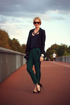Dark emerald pants topped off with a basic black tee and black blazer.