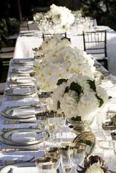 white wedding centerpieces w/silver accents, add grape vines and pops of red:)