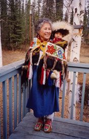 Another baby belt in use - cute baby in a fancy fur ruff! Photo courtesy Charlotte Douthit  Gwich'in Athabascan artist Charlotte Douthit.