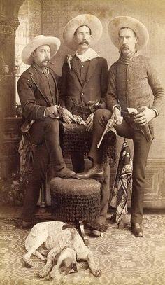 Arizona cowboys and dog, circa 1885-1885.