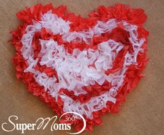 Tissue Paper Hearts - A fun and festive Valentine's Day decoration that will keep the kids busy. A tip for parents: the bigger the heart, the longer it will keep them occupied! Tag: Valentine's Day Crafts For Kids | Easy Valentine's Day Crafts for Kids