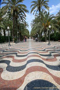 Alicante , Spain  La explanada: este paseo fue uno de los primeros en construirse a finales del XIX. Tras derrumbar las murallas, los escombros fueron aprovechados para crear este paseo. La explanada actual fue construida en los años 60 y tiene en total 6.600.000 teselas. Podemos observar tres colores, siendo uno de ellos el llamado rojo Alicante, color de mármol que sólo se extrae en Alicante, de ahí su nombre.  #alicante #recordgo #rentacar #alquilerdecoche
