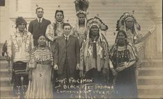 Blackfeet (Pikuni) group during a visit to Carlisle Indian Industrial School in Carlisle, Pennsylvania - 1912 Back row L-R: Unknown (Pikuni), unknown, Two Guns White Calf (Pikuni), Medicine Owl (Pikuni), Long Time Sleep (Pikuni) Front row L-R: Wife of Two Guns White Calf (Pikuni), Moses Friedman (Superintendent of Carlisle Indian School), Three Bears (Pikuni), Wife of Medicine Owl (Pikuni)