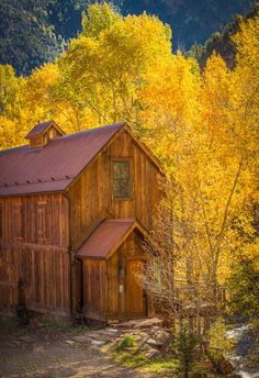 Barn like two story wood home among the golden trees of autumn. Fall peaceful scene. Credit: Warm Colors And Back Roads by Valerie Millett on 500px- I love this one!!