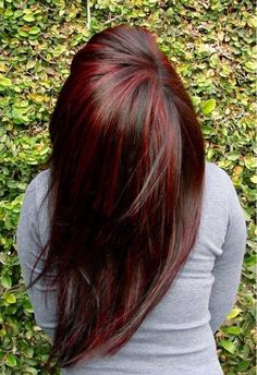 Love this color. Dark brown hair with dark red highlights.