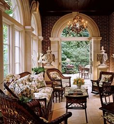 """VIA AD: """"It's English in style—Lutyens with a Palladian twist,"""" designer Marshall Watson says of the circa 1897 Summit, New Jersey, house he and his associate Holmes Easley renovated for Erika Anderson. A porch at Old Westbury Gardens inspired the conservatory's airy design. The brick walls """"help ground the space,"""" Watson notes. The porcelain-and-gilt chandelier is a reproduction of ones found in the orangery at Versailles. January 2006"""