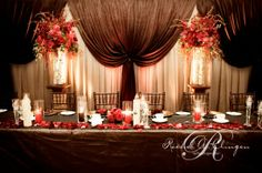 Head table. with purple or gold instead of red.     western wedding backdrop head table decor toronto.jpg